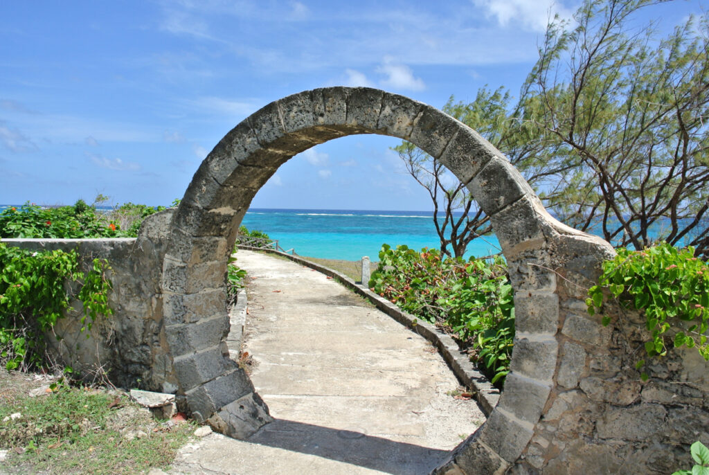 Walking from sam lords castle you pass arches of coral that frame the beach and ocean