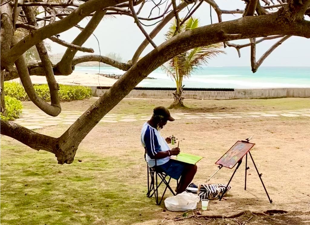 artist-woollyhewitt painting on the beach