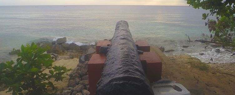 Cannon guarding Speightstown as dusk falls