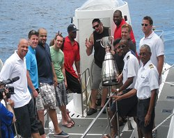 CFL players and official challenge cup as they prepare to take the plunge