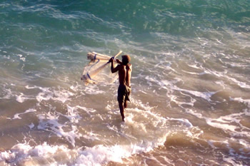 Bajan fisherman casting a net in Bathsheba