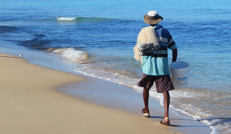 Bajan fisherman strolling along the beach