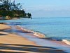 Wide sandy beach with calm waters ideal for swimming and seabathing.